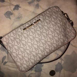 Michael Kors baby pink and white wristlet